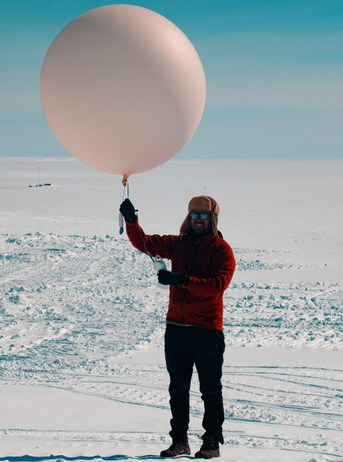 Alexis letting up an atmospheric measurement balloon.